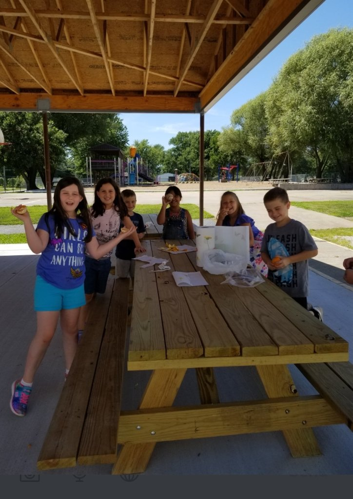 Ms. Chaney's students enjoying their snack in the outdoor classroom.